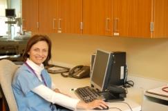 iStock_000003676918XSmall_nurse at desk 2