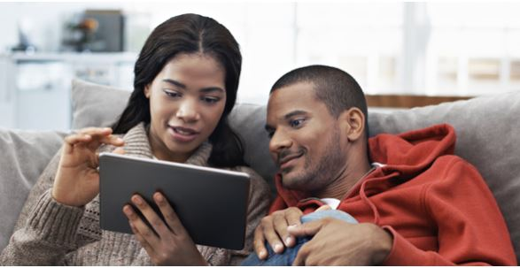 Couple looking at iPad