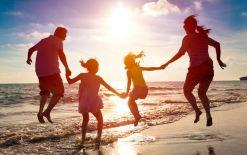 Family jumps on beach